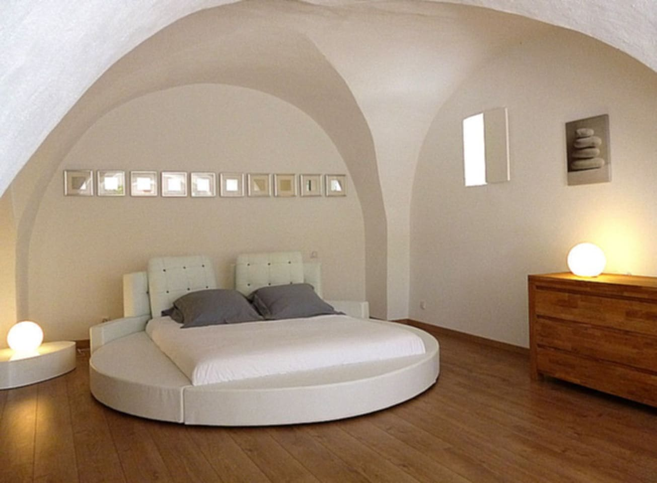 King size round bed in a large voulted bedroom