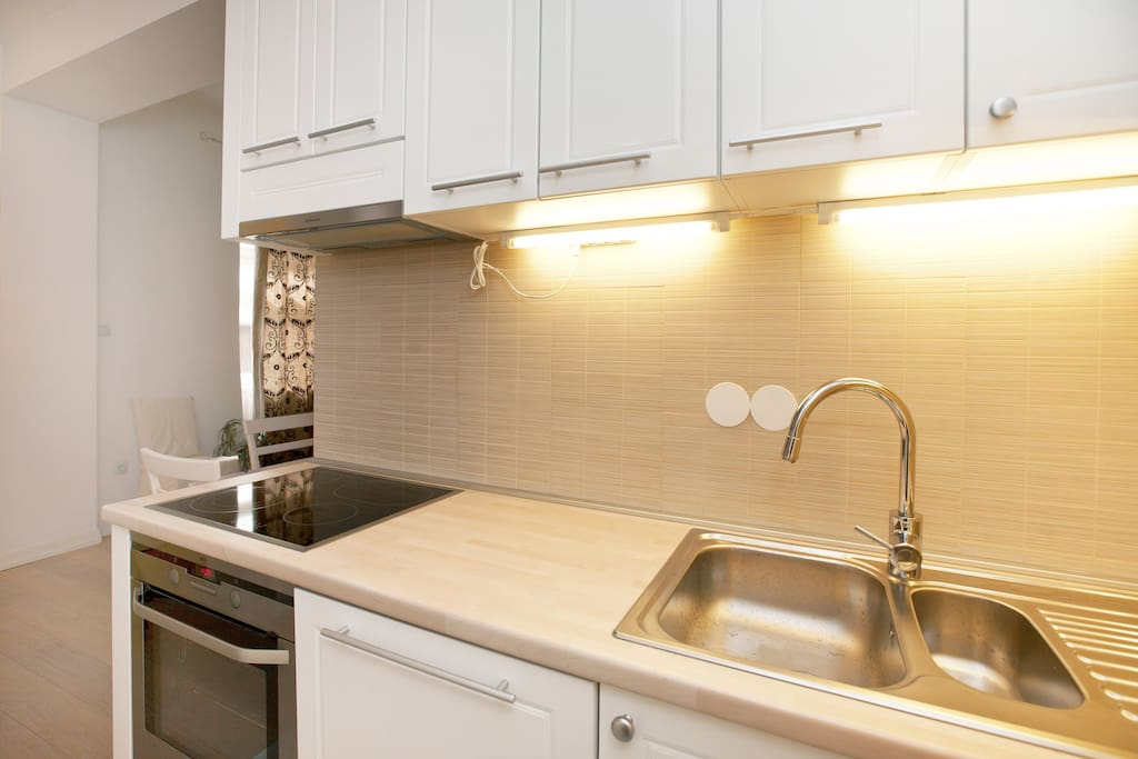 Kitchen, fully equipped with Electrolux new appliances including large fridge, oven, dishwasher etc