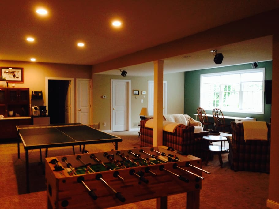 Large spacious family room on lower level with large screen tv, ping pong, foosball