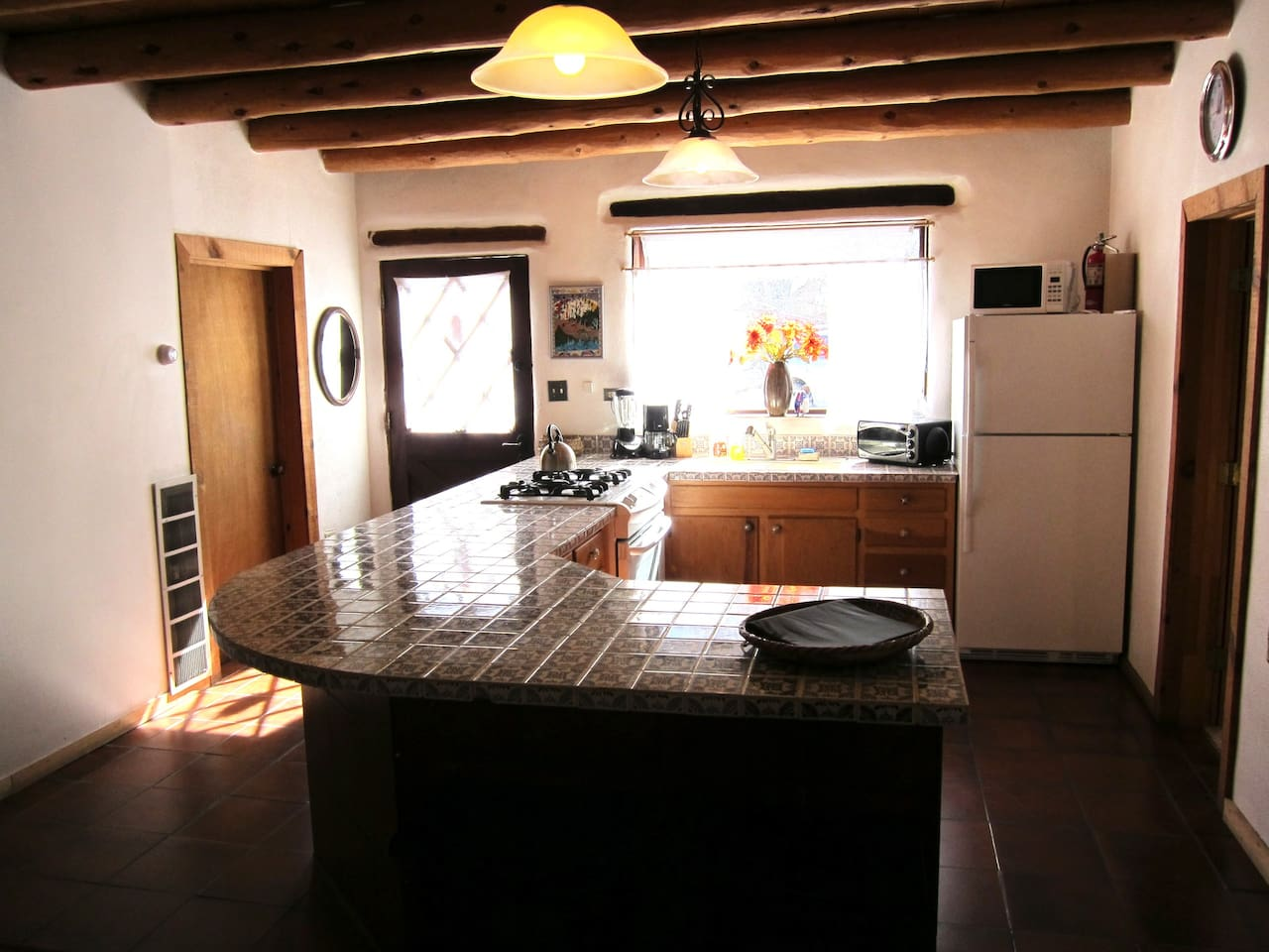 The Sun filled kitchen with Mexican tile counter tops!