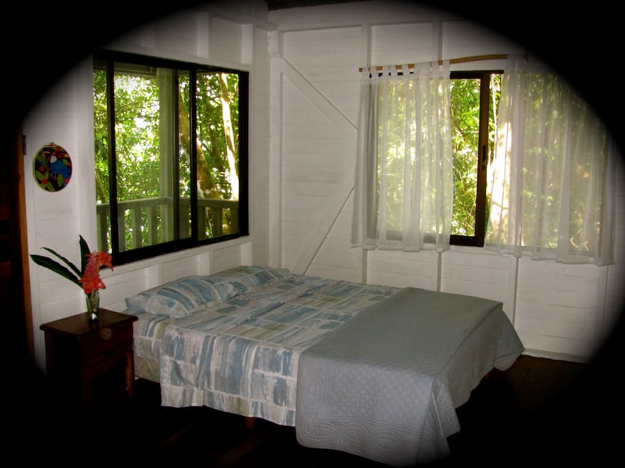 The cabin has one double bed and a set of single bunk beds, with a full bathroom. All window are screened for your comfort. Lighting is provided by battery lanterns