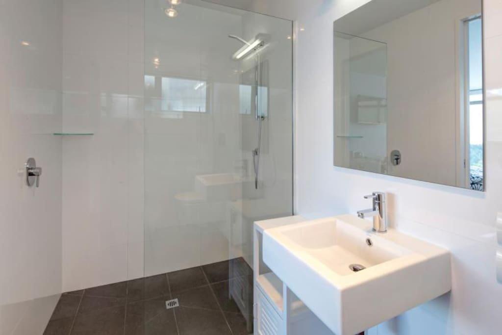 Contemporary, Fully Tiled Ensuite, Heated Tiled Floor During Winter Months.