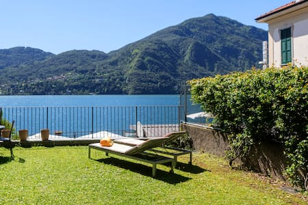 Epic view, large sunny garden, direct on the lake! - Appartement