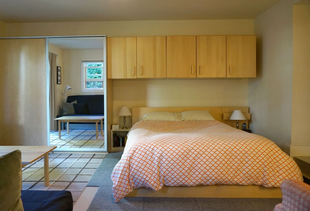 Queen bed with full closet and plenty of drawers