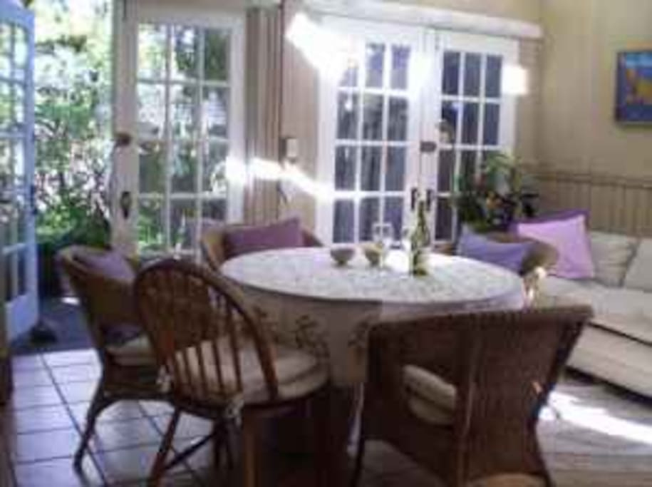 Sunroom/breakfast room with French Doors leading to porch and garden