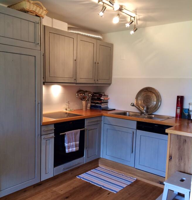 The kitchen with oven dishwasher, coffee machine