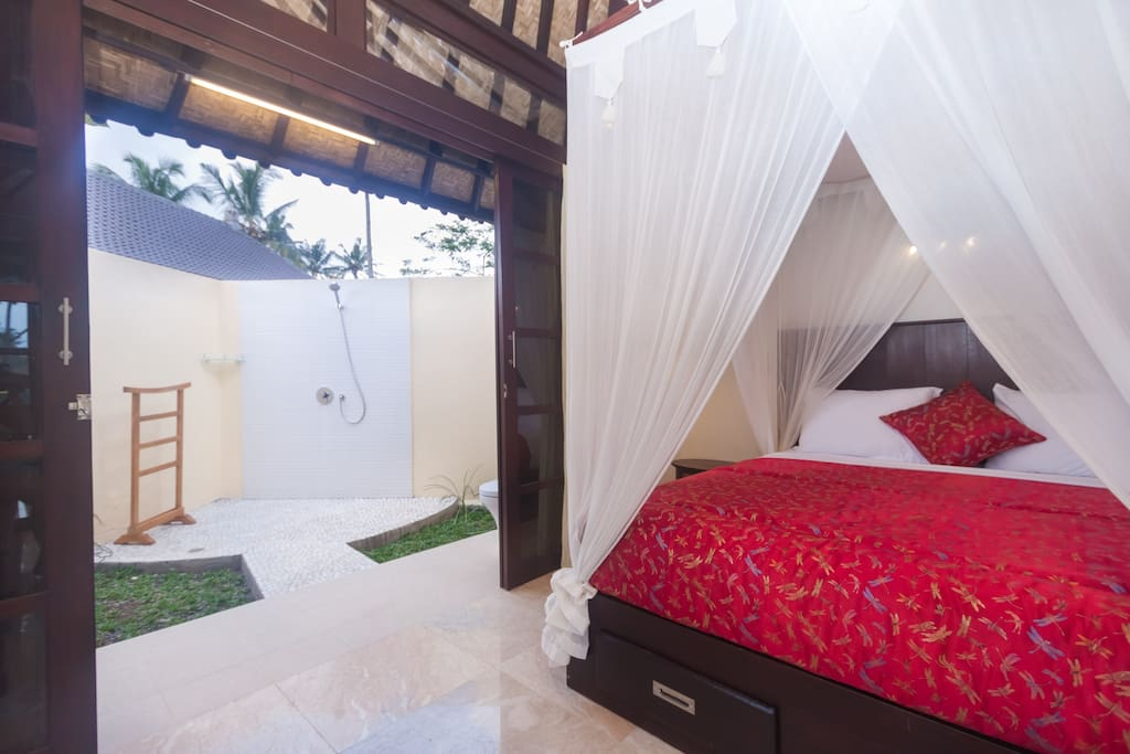 Villa Bedroom opening onto outdoor spacious ensuite.