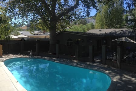 Our home is a lovely 2100 sq/ft pool home in Woodland Hills. The booking includes the use of 2 bedrooms (1 bed in each) and a bathroom as well as the use of all the common rooms and the pool. There is plenty of room for 4 people to be comfortable.