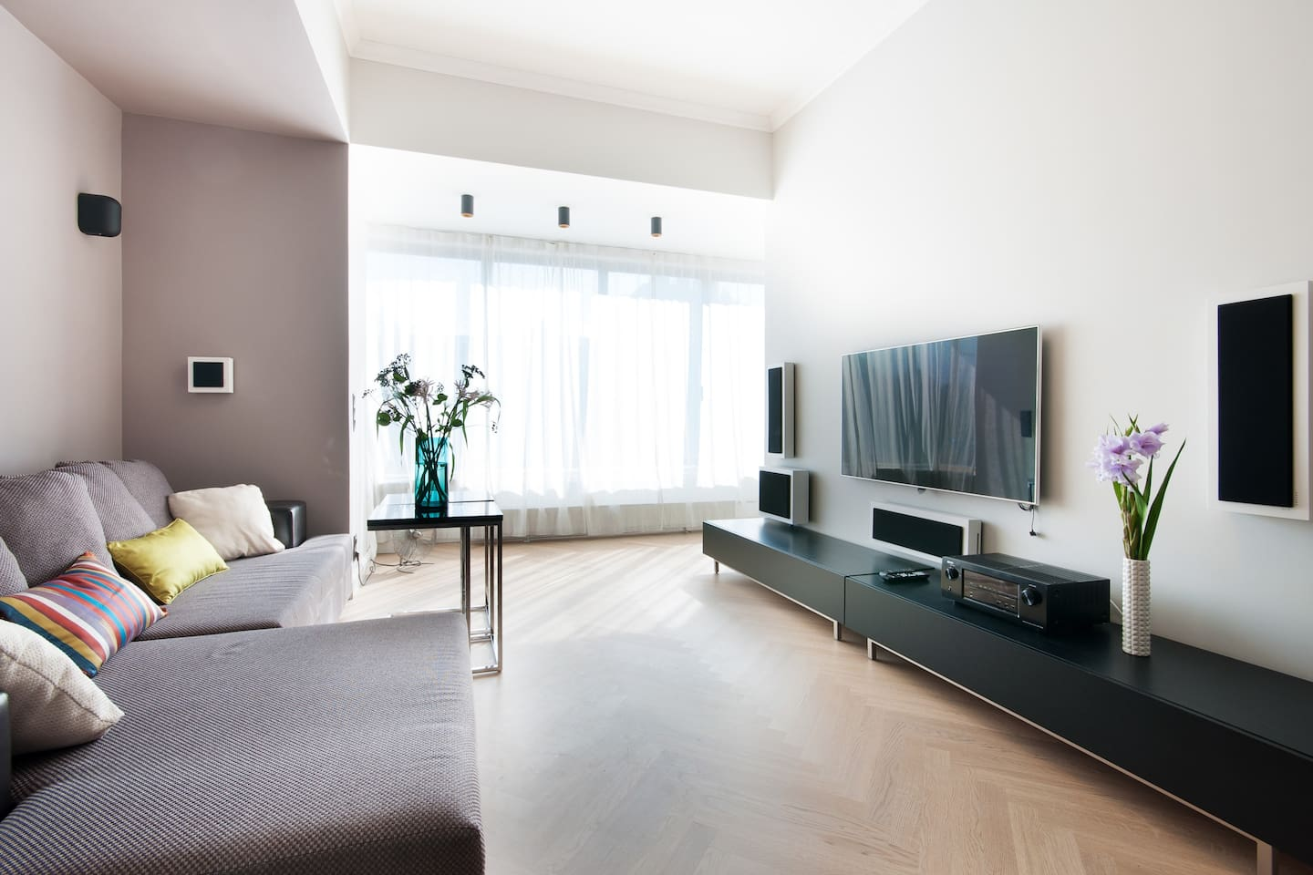 Living room with xxl folded sofa and HI-FI surround system.