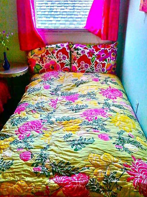 Double Futon Opens Fully ~ Width of A Full-Double & Length Of A Queen ~ Plenty Of Room For 2 People! Lots of fresh air under the window which looks out onto NOLA rooftops & trees!