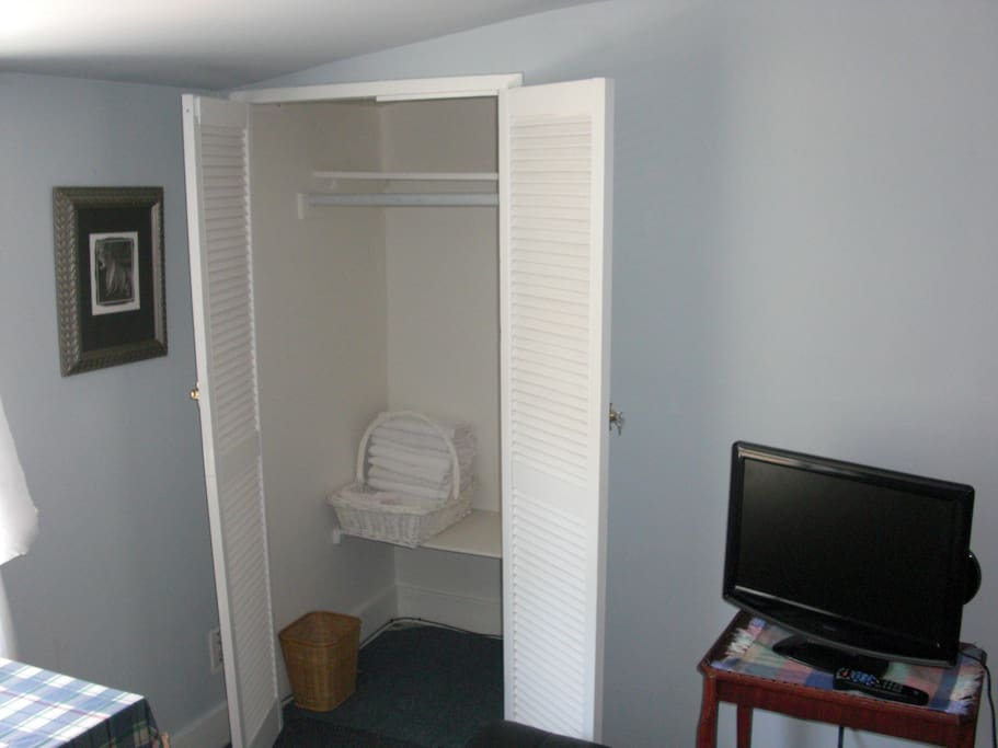 Closet Space and Flatscreen TV in Courtyard Bdrm