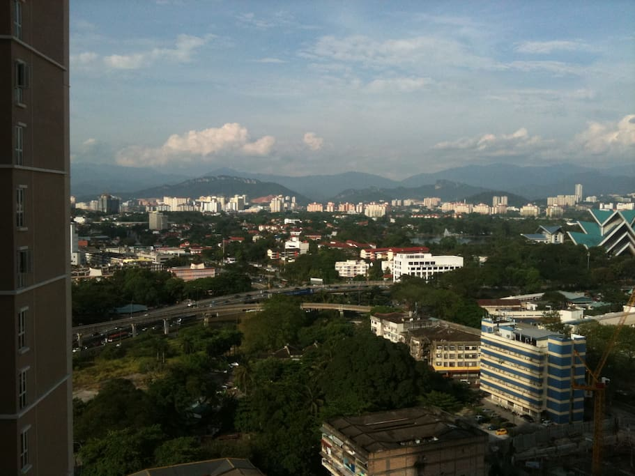 View from apartment. Blue pointed roof (National Theatre), Titiwangsa Park (fountain on lake, next to National Theatre), view of mountain Rydge (far end), monorail track is visible amidst the green in front.