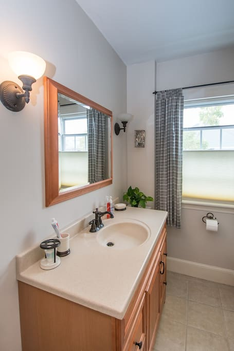 2nd floor bathroom provides easy access adjacent to double bed guest room.