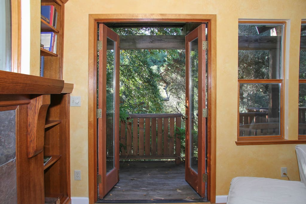 French doors from Living Room to front deck, overlooking front yard with seasonal creek