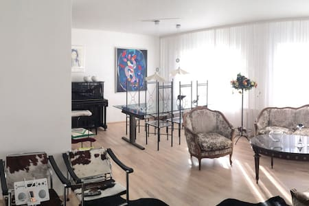 A spacious bedroom with access to kitchen in a newly refurnished apartment right downtown in Reykjavik City Center.