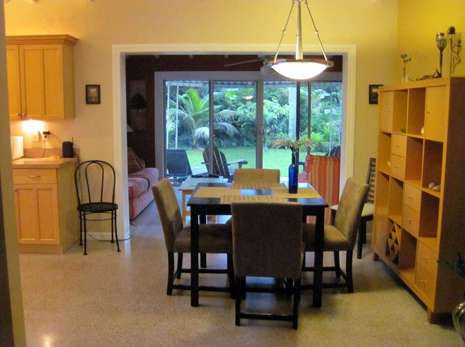 Looking from the living room into the dining area with the Florida room in the back.