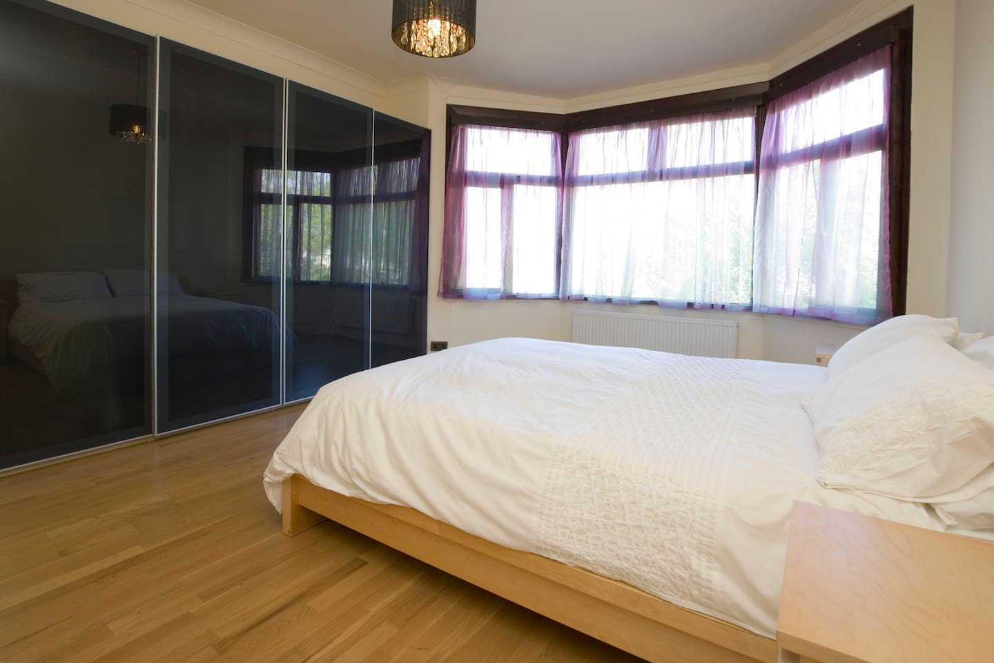 Master bedroom - view from the doorway. Large room with sapce for a cot, huge wardrobe and air-conditioning