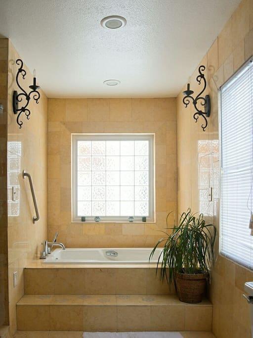 Luxurious bathtub in Master bedroom.