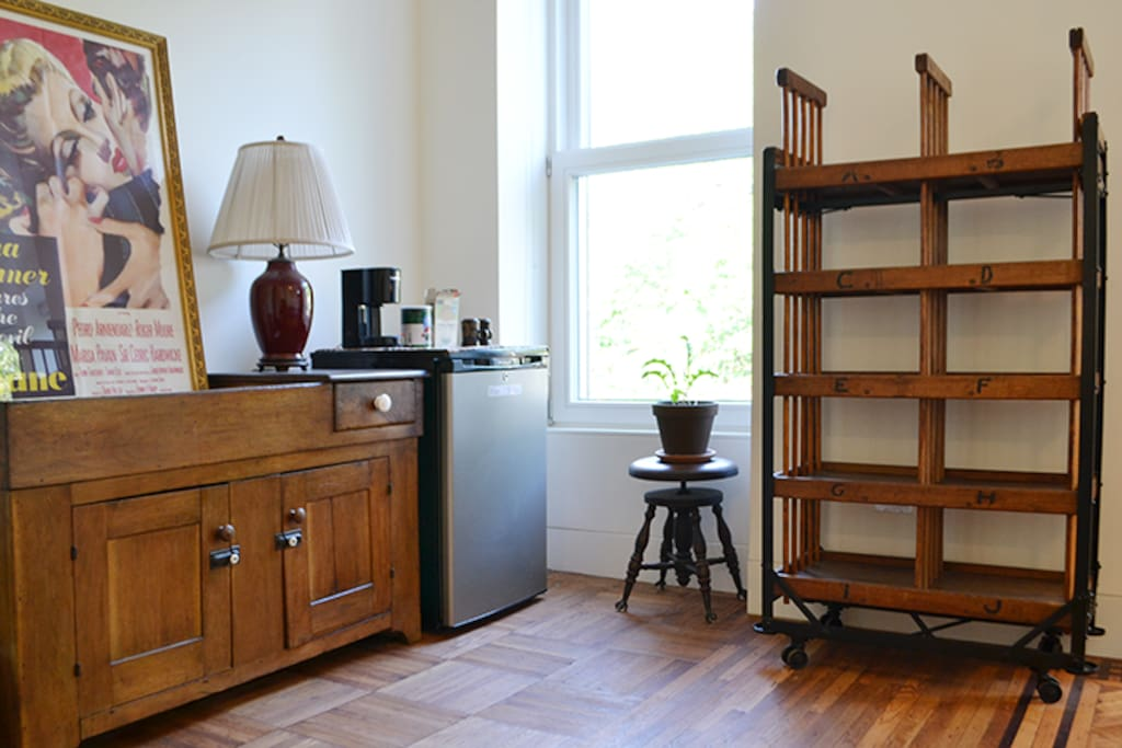 A bookshelf and 2 closets allow you to really settle in. Also, check out the mini-fridge and coffee pot!