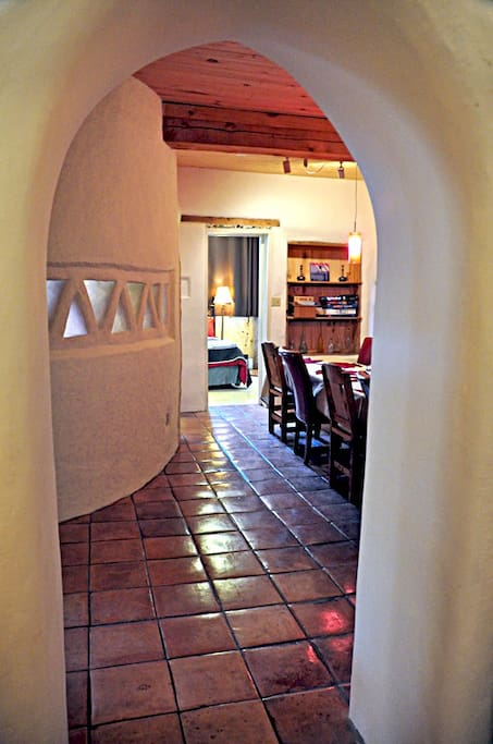 Curved walls, arched doorways and Saltillo tile floors typify the warm style of the Southwest.