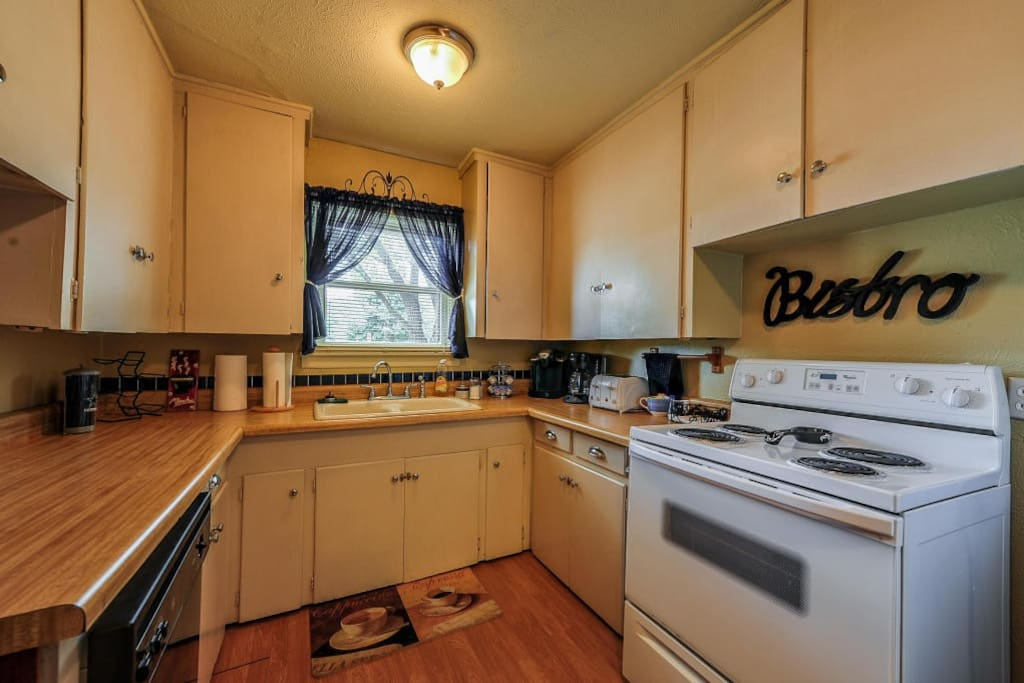 Kitchen is a comfortable size, with an electric stove and oven, lots of dishes and pots and pans for cooking a delicious meal.  There is a Microwave, 4 piece toaster, toaster oven, regular coffee pot, Keurig coffee maker, a blender, waffle maker, as well