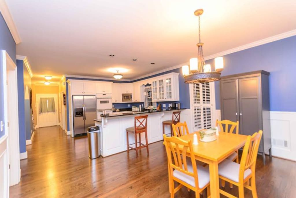 Open Concept Kitchen with hardwood floors and a breakfast table