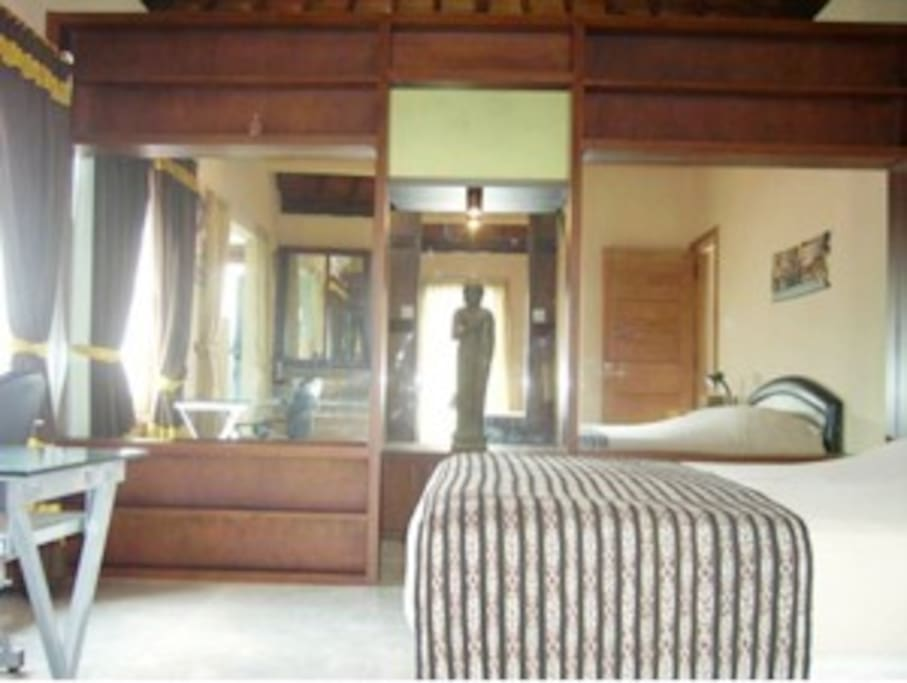 Spacious walk-in wardrobe for comfortable longer stays. Almost a second bedroom!