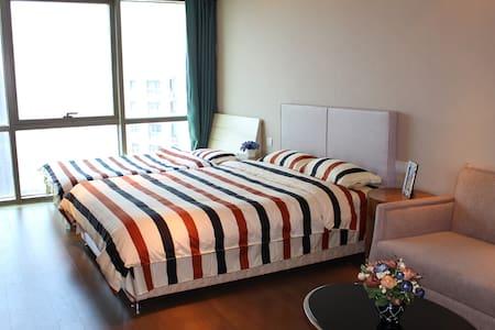 邮轮母港旁无敌海景家庭公寓-YOYO'S HOME - Qingdao - Apartamento