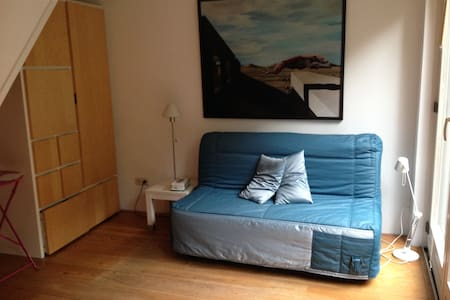 small nice room in great house!