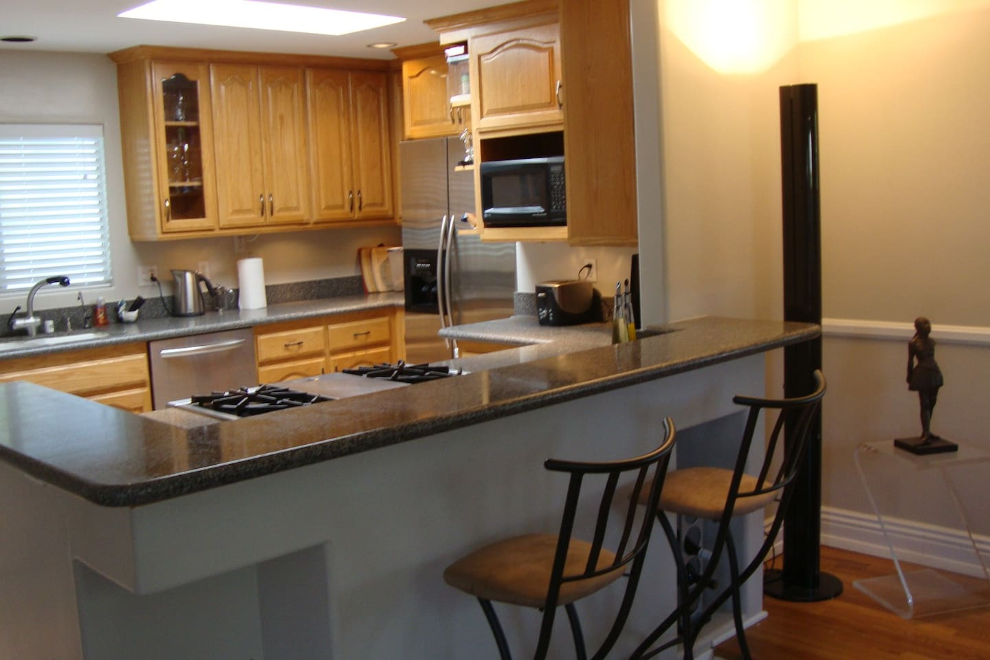 Fantastic kitchen with state of the art appliances, and open bar with stools.