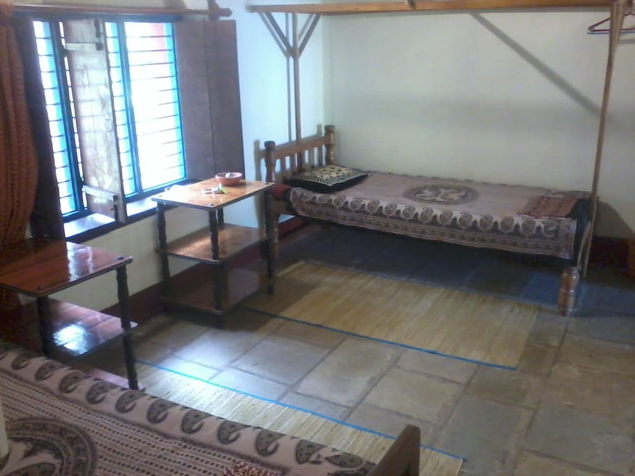 Spacious heritage room with original stone tiles flooring.