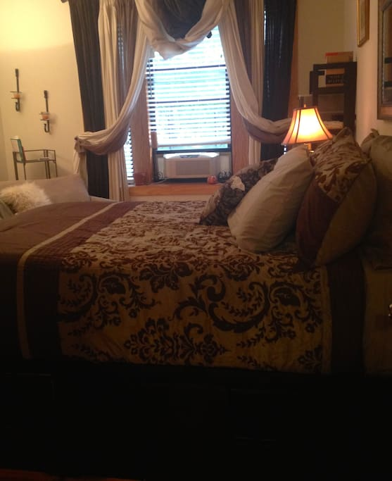 Master Bedroom with Queen Captain Bed, Flat Screen TV and Dressers and Desk for your use