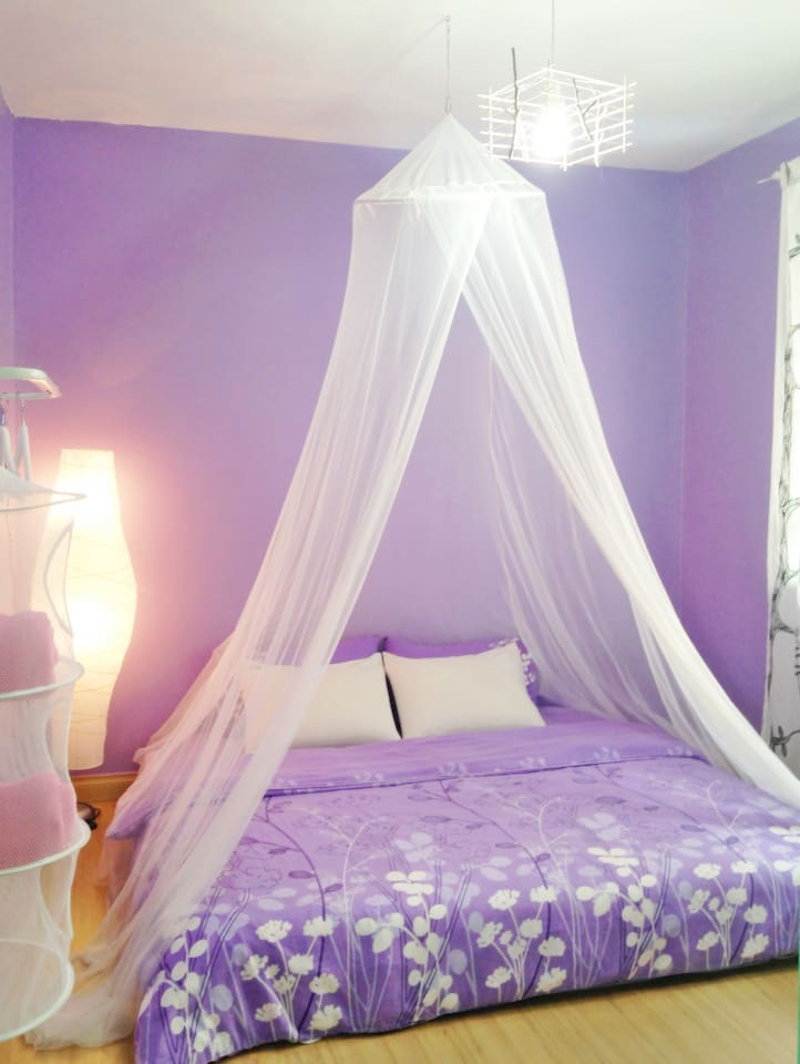 Purple romance room: King size bed