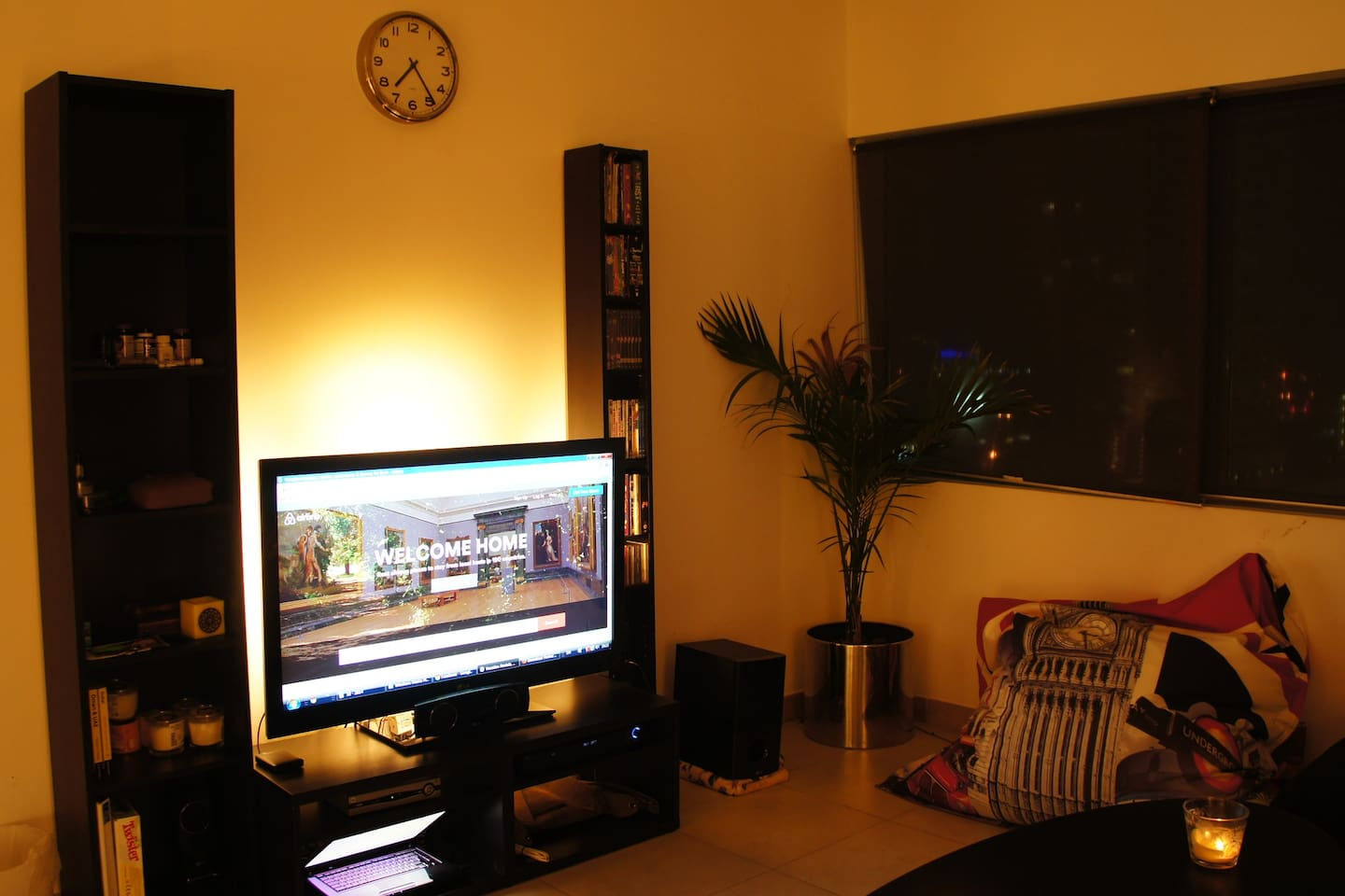 """52"""" Full HD screen with home theater, cable TV & 2,000 HD movies library."""