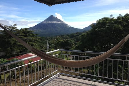 Enjoy spectacular Volcano Arenal and Lake Arenal views from every room.   Open living area, spacious balconies, and rooftop patio provide beautiful indoor & outdoor living space in this lush tranquil jungle village just 35 min from La Fortuna.