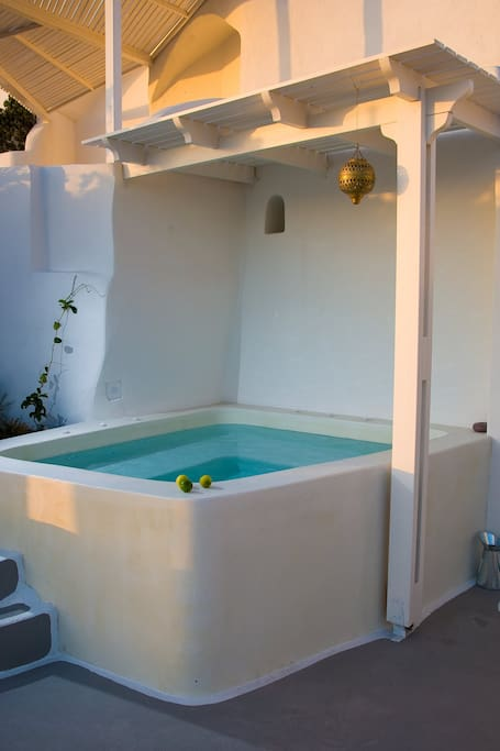 A private jacuzzi located outside with sunset views to create memories...
