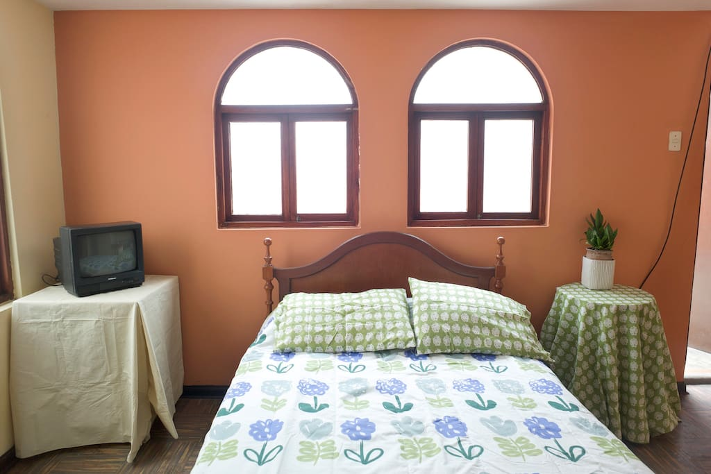 Ample and well lit bedroom includes table, chair, a small TV set and large closets. Linens provided. We wash linens 1 time per week, 2 or more week periods.