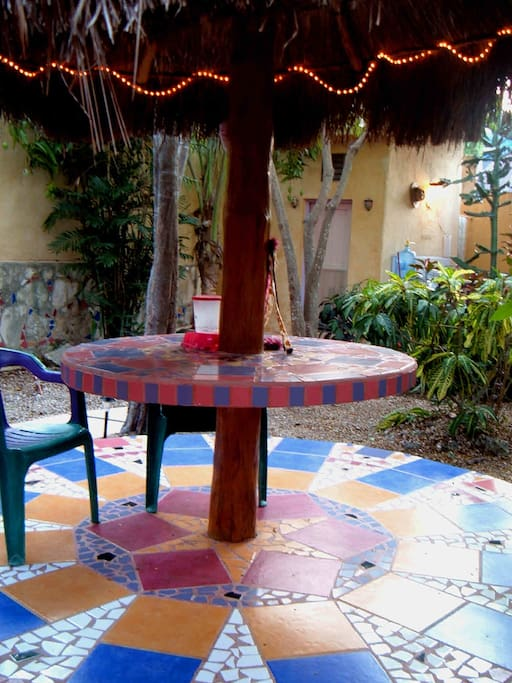 back patio table bursting with color