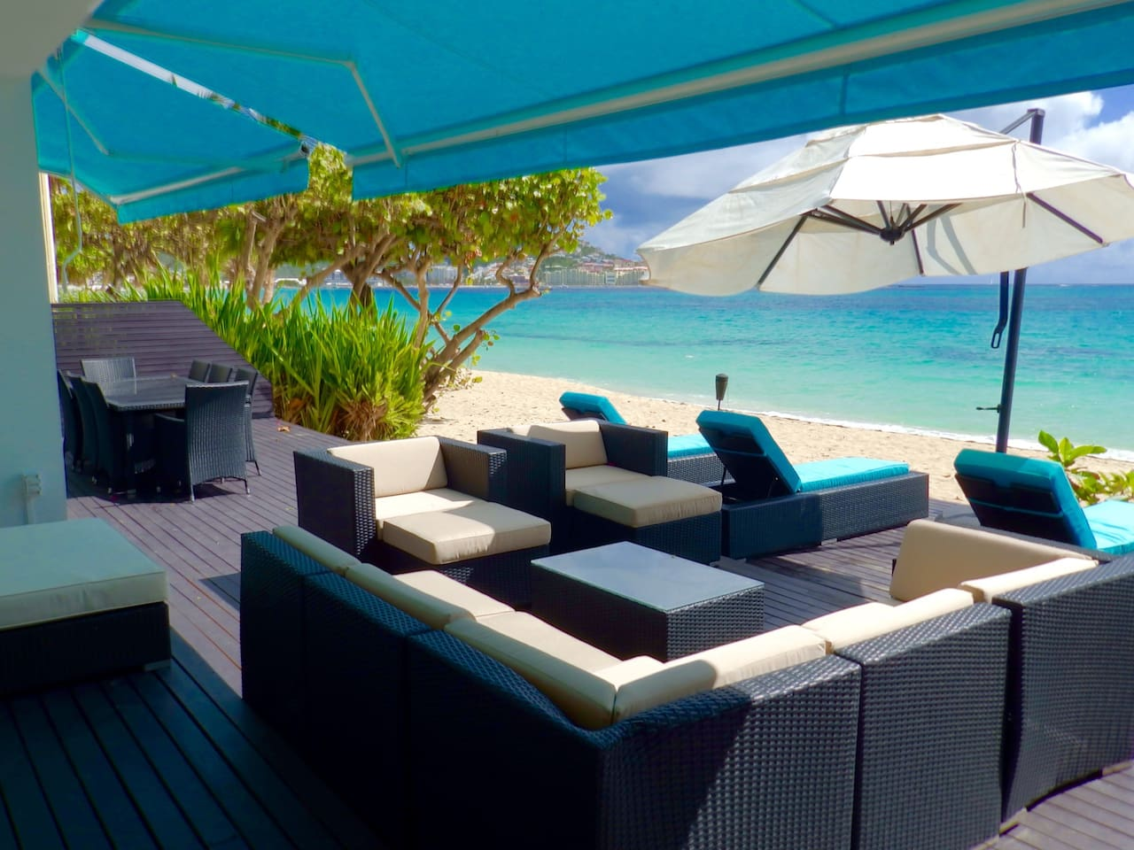 The large beach deck that sits on the beautiful 2 miles of White Sand Beach; offers dining for 8, an ocean lounge with a day bed and 4 beautiful sun chairs overlooking the blue Caribbean Sea.