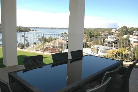 Modern, Executive apartment, tastefully furnished.   The apartment enjoys stunning views of the Swan River and is situated in the peaceful suburb of Bicton, just 10 minutes from the Port City of Fremantle and short 20-30 minutes by car to Perth.