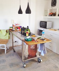 Modern and bright, east meets west, loft with kitchen on wheels, fireplace and big terrace. Meant for two-three people, but fits 3 people for a shorter period. Quite location, in walking distance from some of the best restaurants and music venues.