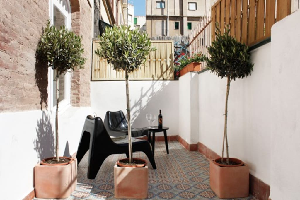 A private terrace of one of the back rooms