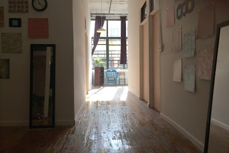 Room in a spacious, classic loft in East Williamsburg/Bushwick with high ceilings, a wall of windows, open kitchen, in an artsy building.  Best neighborhood in Brooklyn; one block from Morgan L station, steps to bars, clubs, galleries, restaurants.