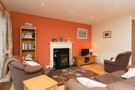My modern house is comfortable and welcoming with a homely feel.  It is very clean and organised. It has 3 bedroom 2 of which have double beds and the third a single.  There is a nice outdoor space also which is lovely on a sunny day!
