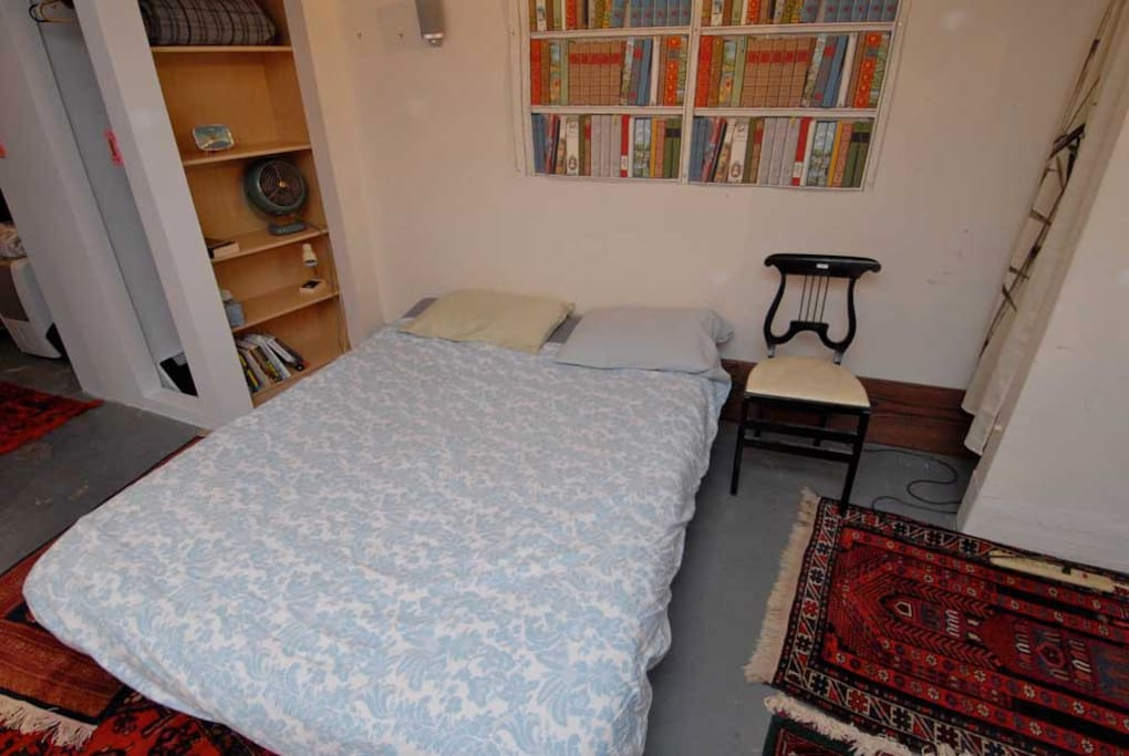 The guestroom bed  (with different sheets--who knows what color you'll get?)