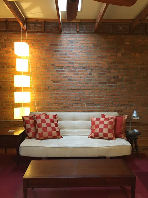 Couch folds in to a double-size bed and there are a supply of linens in the closet.  This room also has a skylight and exposed beams and brick.