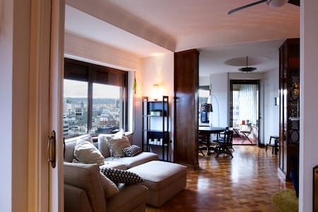 Our apartment is located on the top of one of the highest buildings in town, you can see Montjuic, Tibidabio, Sagrada Familia from our balcony. 2 blocks from Placa Catalunya, great for who comes from the airport by aerobus. You will love it!!