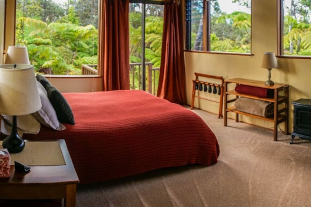 Spacious bedroom with big picture windows all around.  Wake up in the morning to Hawaiian song birds and fall asleep watching the night sky and stars.