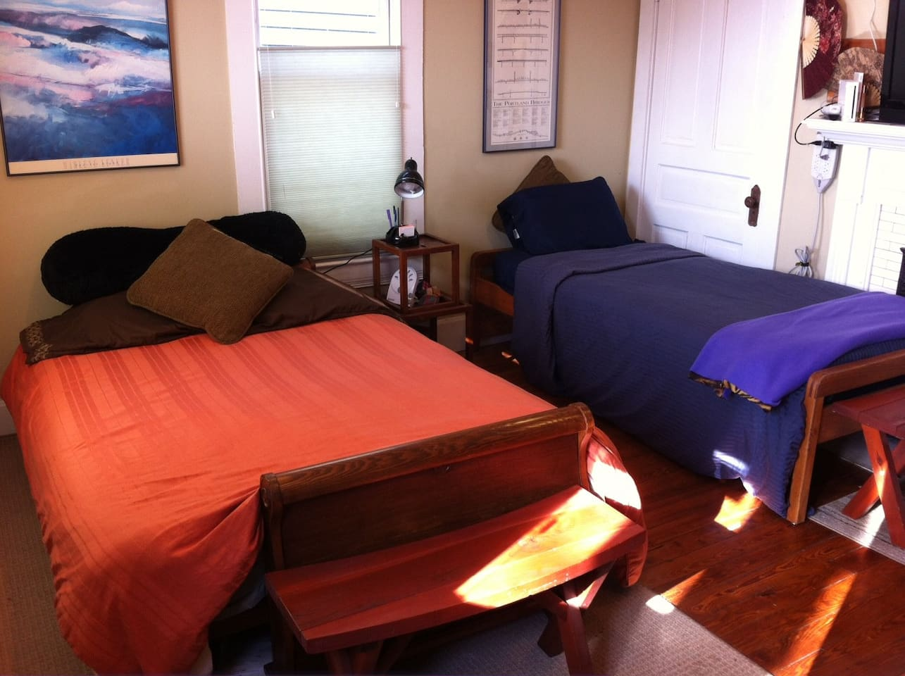 This room has a Temperpedic memory foam queen mattress and a firmer twin mattress.  It will be cozy for three people.