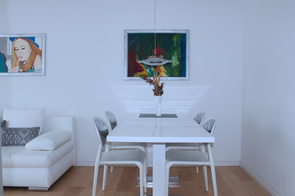 Dining table and Italian designer chairs.